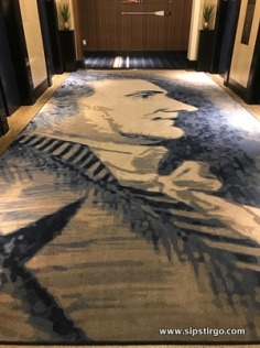 A luxury hotel with a sense of humor. The carpets figure profiles of historical figures.